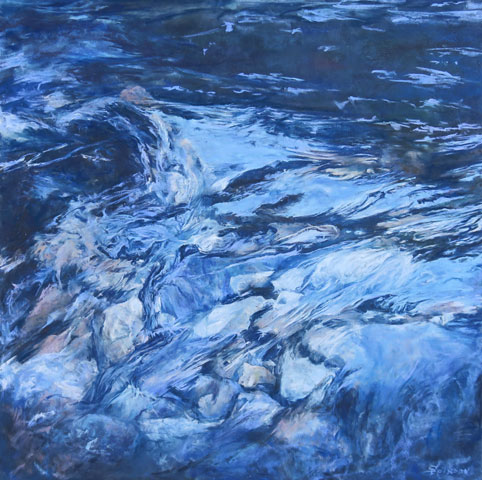 Swift flow of intense blue water on gently sloping stones