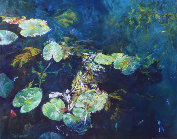 Leaves of a rich array of green color floating on the water